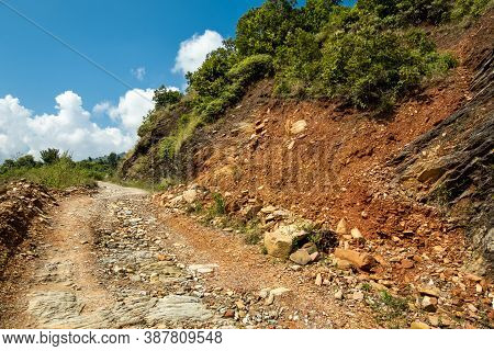 An Old Rocky Dirt Road In The Mountains With Traces Of A Recent Landslide On The Nearby Side Of The