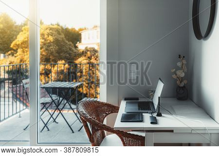 An Interior Of A Cozy Room With A Desktop And A Laptop On It With A Usb Hub And Wireless Graphic Tab