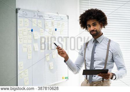 Kanban Board Plan. African American Business Coach Teaching Lesson