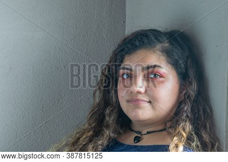 Portrait Of Beautiful Latin Mexican Woman Looking At Camera. Chubby Girl