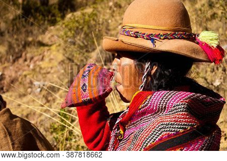 Sacred Valley, Peru- August 31, 2011: Portrait Of A Woman Dressed With Traditional Clothes Making A