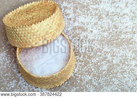 Wicker Box Filled With Sea Salt On Cotton Cloth. View From Above And Copy Space For Your Text. Coars