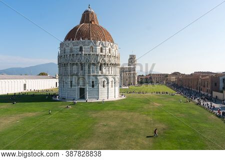 Pisa, Italy-october 21, 2018:view Of The Famous Leaning Tower And The Medieval Cathedral Located In
