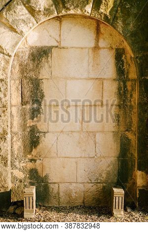 Oval Arch In A Stone Wall With Ledges In An Old Building.