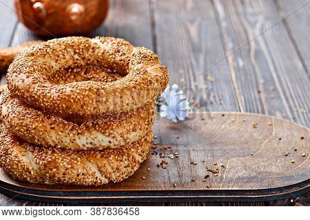 Freshly Baked Simit On A Wooden Table - Sesame Bun With Copy Space (turkish Bagel - Gevrek Or Kuluri