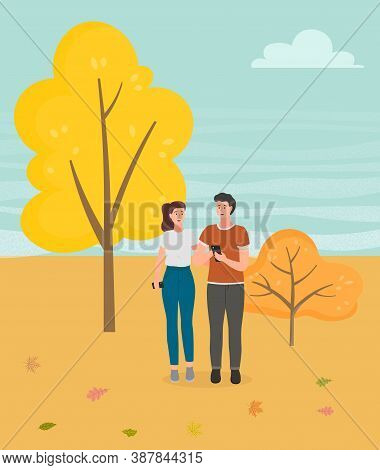 Couple Walking In A Park. Young Guy And Girl Holding Hands Walking In Autumn Garden, Romantic Walk.