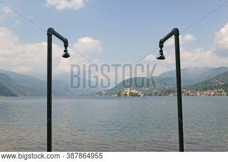 Tap Factories Concept Over San Giulio Isle, Orta Lake, Piedmont, Italy