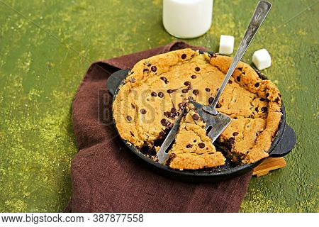Dessert, Cookies In A Skillet With Chocolate Drops In A Cast Iron Skillet On An Olive Green Concrete