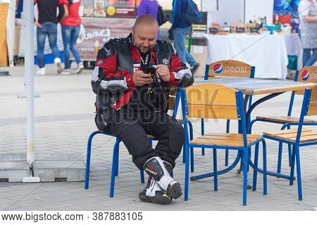 Dnipro, Ukraine - May 11, 2019: Portrait Of Mature Biker Sitting In Open Air Cafe On The Annual City