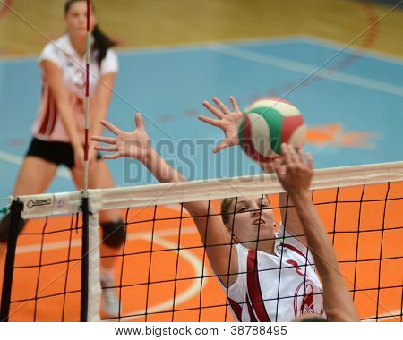 KAPOSVAR, HUNGARY - OCTOBER 7: Timea Kondor in action at the Hungarian I. League volleyball game Kaposvar (white) vs Veszprem (black), october 7, 2012 in Kaposvar, Hungary.