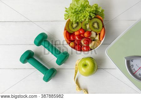 Diet Health Food And Lifestyle Health Concept. Sport Exercise Equipment Workout With Green Apple And