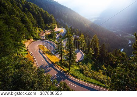 Aerial View Of Maloja Pass Road In Switzerland At Sunset. This Swiss Alps Mountain Road Is Located I