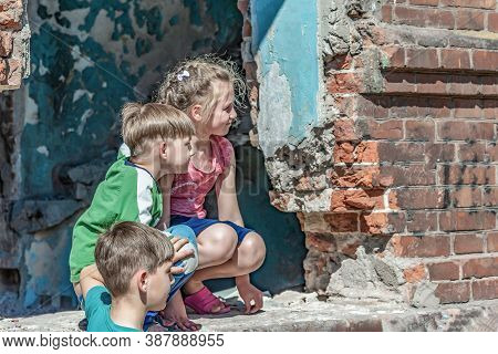 Three Children In A Destroyed House Are Hiding From Military Conflicts, Refugee Children Have Suffer
