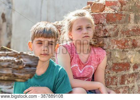 Poor Orphans Against The Background Of Destroyed Buildings, The Concept Of The Life Of Street Childr