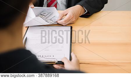 Businessman Giving Money While Making Deal To Agreement A Real Estate Contract And Financial Corpora