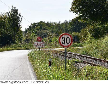 Road Sign That Warns Drivers That Maximum Speed Is 70 Kilometers Per Hour