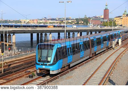 Stockholm, Sweden - August 24, 2018: People Ride Blue Metro Train In Stockholm, Sweden. Stockholm Is