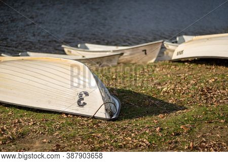 Old Fishing Boats Lying Overturned On Grassed Shore