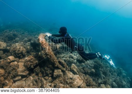 September 10, 2020. Anapa, Russia. Professional Freediver In Wetsuit With Mono Fin Underwater In Tra