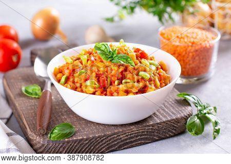 Red Lentil Soup With Ingredients On Light Background. Traditional Turkish Or Arabic Lentil And Veget