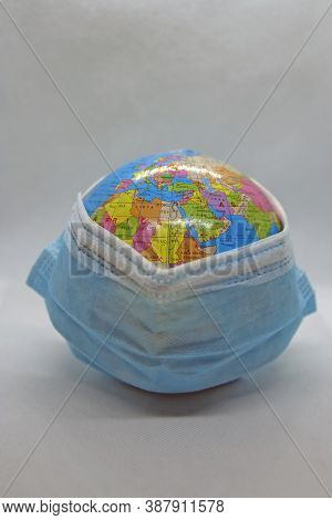 World Wearing Protective Mask. Globe With A Surgical Mask. Covid Protection.