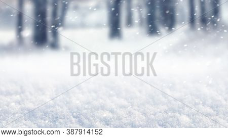 Abstract Winter Background With Snow And Blurred Trees During Snowfall