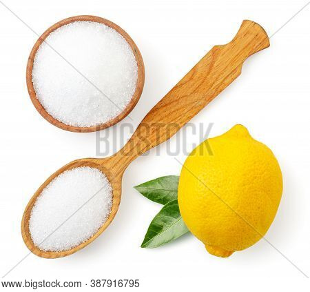 Citric Acid In A Wooden Plate And Spoon With Lemon Isolated. Lemon Acid Top View