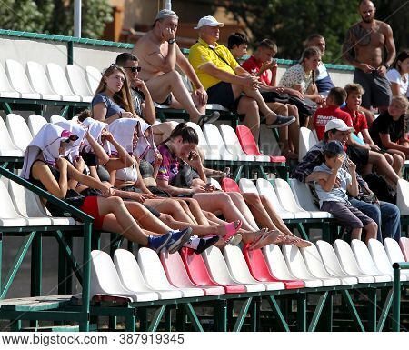 Odessa, Ukraine - Circus, 2020: Spectators In The Stands Of A Small Rugby Stadium As Their Favorite