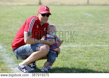 Odessa, Ukraine - Circus, 2020: Spectators With Young Children In The Stands And Grassy Field Of A S