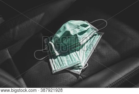 Medical Face Mask Placed On Leather Car Seat Inside To The Car , Coronavirus (covid-19) Prevention C