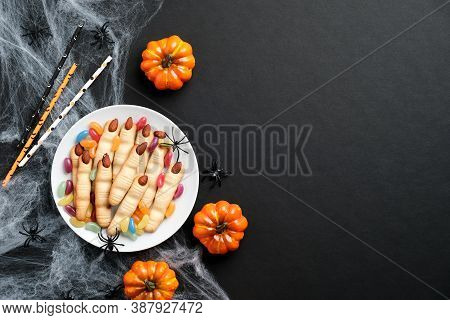 Happy Halloween Holiday Concept. Halloween Hand Fingers With Almond Nails, Pumpkins, Spiderweb On Bl