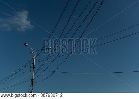 Ordinary City Lamppost With Three Glass Lamps. Black Wires All Around. Evening Blue Sky Gradient  Ba