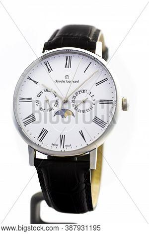 Geneve, Switzerland 01.10.2020 - Claude Bernard Man Swiss Made Watch Moon Calendar White Dial Leathe