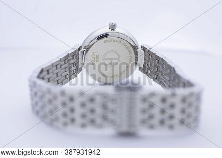 Geneve, Switzerland 01.10.2020 - Claude Bernard Woman Swiss Made Watch Back Case Metal Bracelet Isol