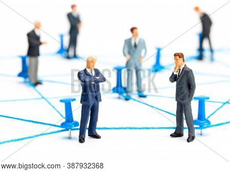 Business Connection. Communication Between Businessmen. Network Of Threads And Office Pins. Isolated