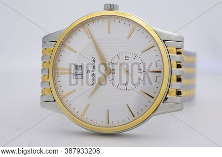 Geneve, Switzerland 01.10.2020 - Claude Bernard Swiss Made Watch Gold Pvd Coating White Dial Isolate