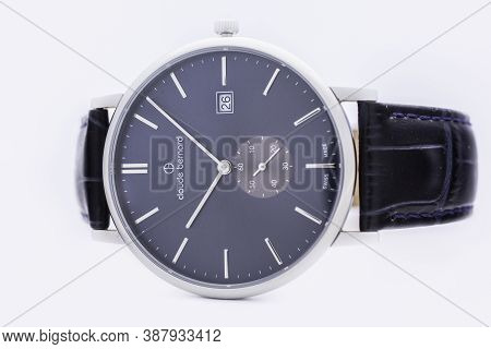 Geneve, Switzerland 01.10.2020 - Claude Bernard Man Swiss Made Watch Blue Dial Leather Strap Isolate