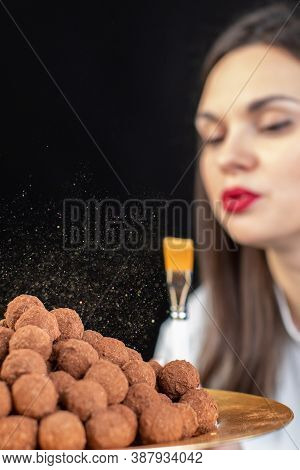 Close-up Chef Decorates Pile Of Delicious Dark Chocolate Truffles With Gold Luster Dust, Chocolatier