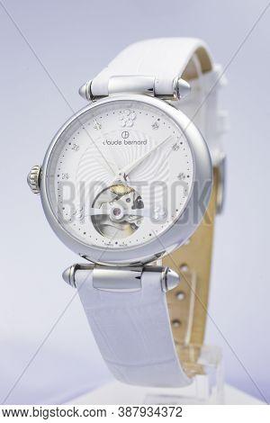 Geneve, Switzerland 01.10.2020 - Claude Bernard Woman Swiss Made Mechanical Watch White Dial Leather