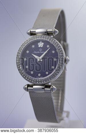 Geneve, Switzerland 01.10.2020 - Claude Bernard Woman Swiss Made Watch Blue Dial Decorated With Jewe
