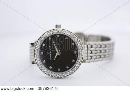 Geneve, Switzerland 01.10.2020 - Claude Bernard Woman Swiss Made Watch Decorated With Jewels Black D