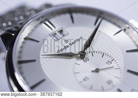 Geneve, Switzerland 01.10.2020 - Claude Bernard Swiss Made Watch Close Up Detail. Date Indication 14