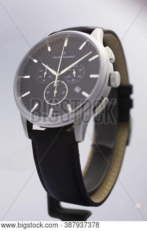 Geneve, Switzerland 01.10.2020 - Claude Bernard Man Swiss Made Watch Black Dial Leather Strap Isolat