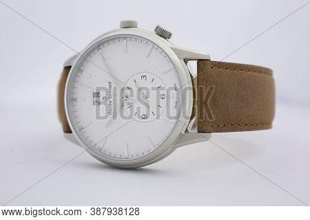 Geneve, Switzerland 01.10.2020 - Claude Bernard Man Swiss Made Watch White Dial Leather Strap Date I
