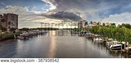 Boats Docked In A Harbor Along The Cocohatchee River In Bonita Springs, Florida