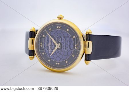 Geneve, Switzerland 01.10.2020 - Claude Bernard Swiss Made Watch Gold Pvd Coating Blue Dial Leather