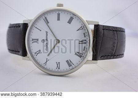 Geneve, Switzerland 01.10.2020 - Claude Bernard Swiss Made Watch White Dial Leather Strap Classic De