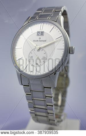 Geneve, Switzerland 01.10.2020 - Claude Bernard Man Swiss Made Watch White Dial Metal Bracelet. Swis