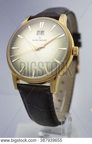 Geneve, Switzerland 01.10.2020 - Claude Bernard Man Swiss Made Watch Gold Pvd Coating Leather Strap