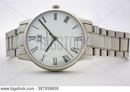 Geneve, Switzerland 01.10.2020 - Claude Bernard Man Swiss Made Watch White Dial Metal Bracelet Isola